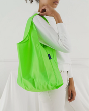 Load image into Gallery viewer, neon colored standard bag hanging off shoulder