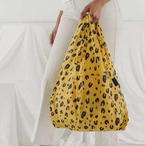 leopard print bag hanging from hand