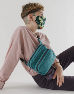 fanny pack worn across chest in malachite color