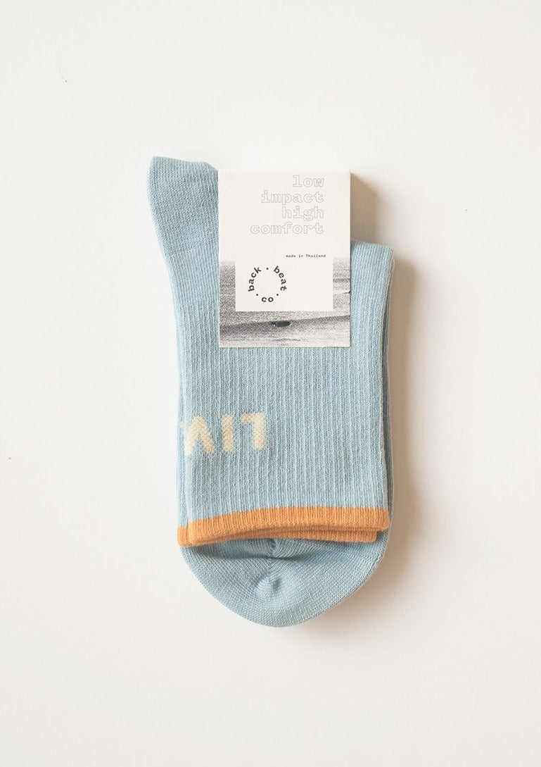 sky colored crew socks with words easy livin