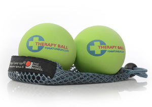 "Two green massage balls printed with ""Therapy Ball"" on mesh bag"