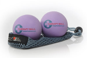 "Two purple massage balls printed with ""Therapy Ball"" on mesh bag"