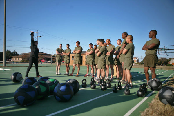 Military exercising with kettlebells