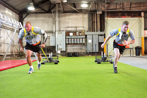 Army Pulling Sleds in CrossFit workout