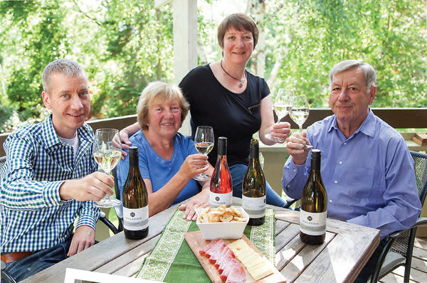 Group of Four Toasting with Wine and Posing for Picture - Trail Estate
