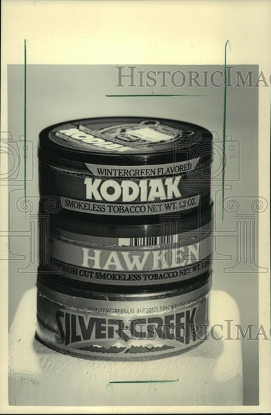 1984 Press Photo Cans of tobacco snuff has become a popular alternative - Historic Images