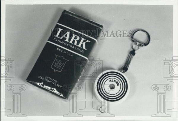 Press Photo Lark Cigarettes Comes With Tiny Alarm Key Chain - Historic Images