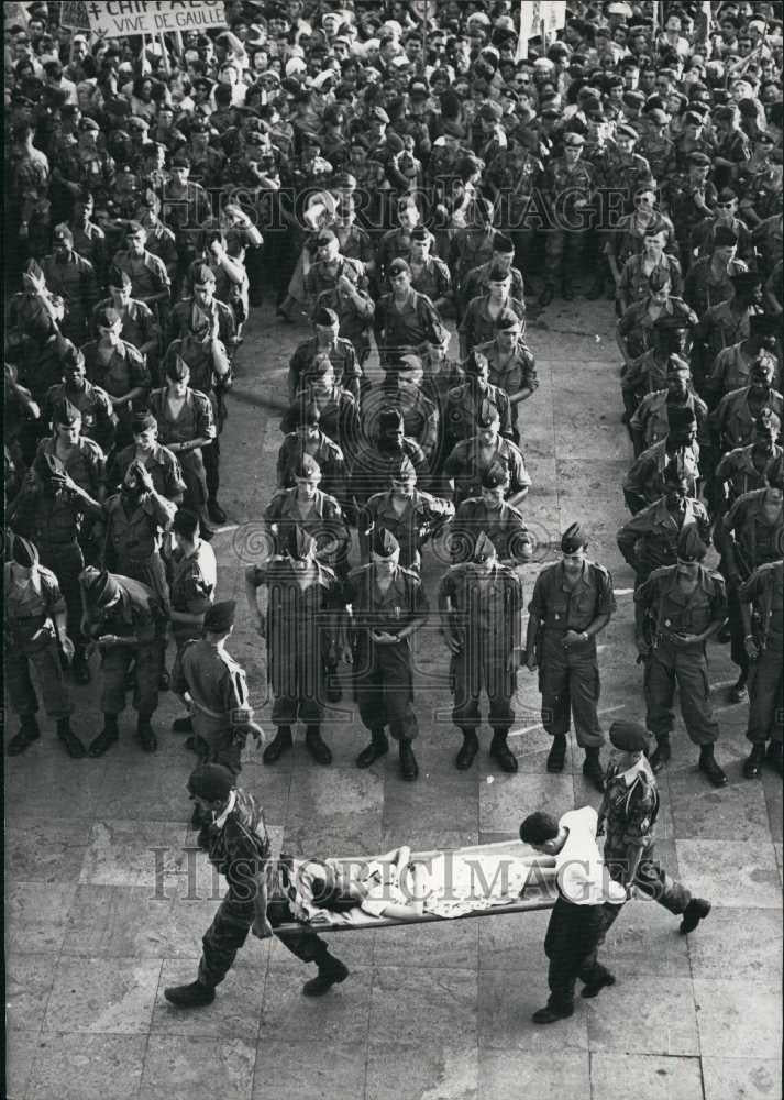 Press Photo A woman who passed out at General De Gaule review in Algiers - Historic Images