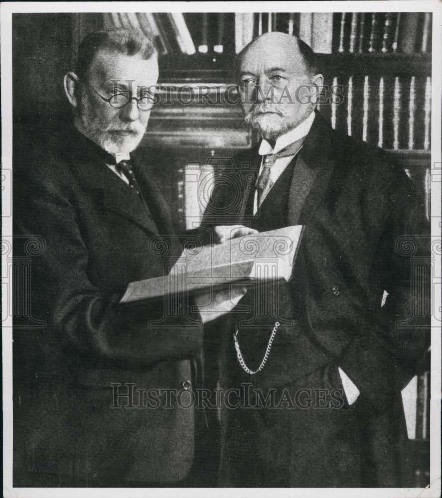 Press Photo Mr Paul Egvlig and Emil Begving with a book - Historic Images
