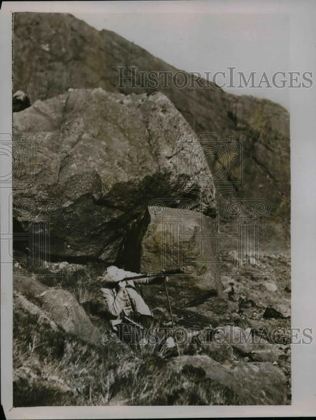 1928 Press Photo Hunter in Cullin Hills, Scotland looks for red deer - nea29429 - Historic Images