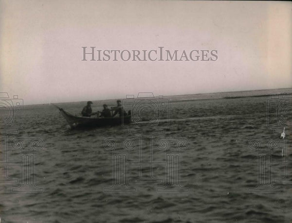 1923 Press Photo Two men paddle a boat while other man spear fishes - nea30453 - Historic Images