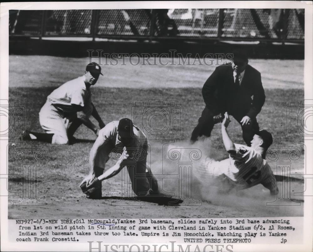 Press Photo Yankees Gil McDougald slide safe of game with Cleveland. - Historic Images