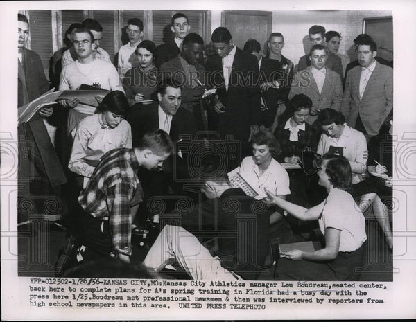 1956 Press Photo Lou Boudreau interviewed by newsmen & high school reporters - Historic Images