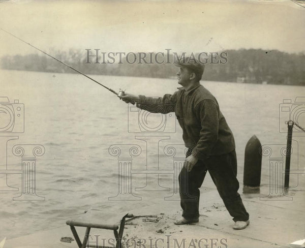 1919 Press Photo A fisherman on the banks of a river in cold weather - Historic Images