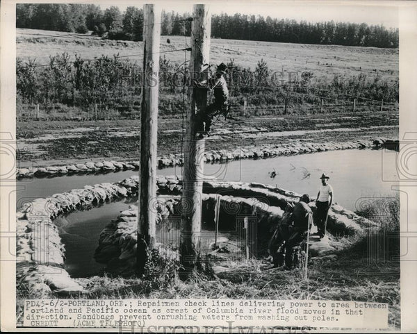 1948 Press Photo Portland, Ore. repairmen check power lines after floods - Historic Images