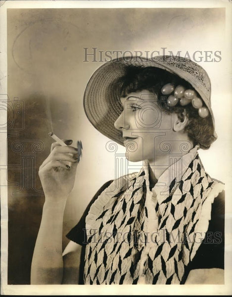 "1934 Press Photo lady wearing a bonnet called ""Sweetheart"" featuring cherries - Historic Images"