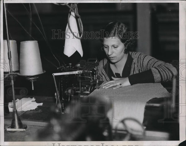 "1934 Press Photo ""Serging"" Edge of Fabric Carmella Maleonico - nec30913 - Historic Images"