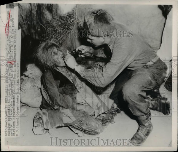 1949 Press Photo Aged Navajo woman examined by Capt Geo W Magladry - Historic Images