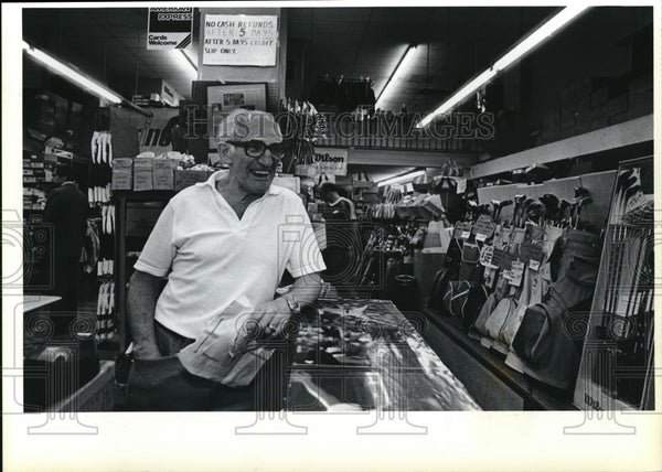 1983 Press Photo Harry Caplan at counter in a shop - ora00125 - Historic Images