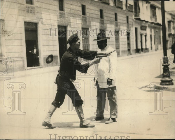 1934 Press Photo Man Stopping A Possible Sniper - Historic Images