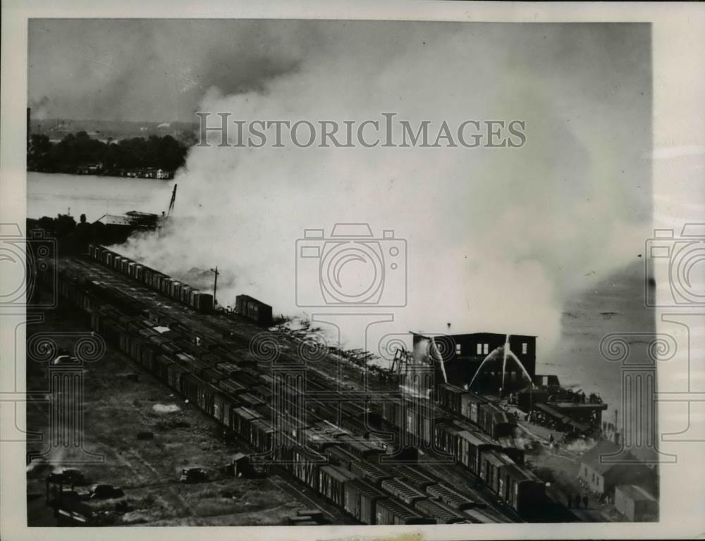 1945 Press Photo Port Edward, Ont Fireman pour water on remains of Long Docks - Historic Images