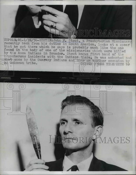 1956 Press Photo John M Stout, back from duties in South America, looks at spear - Historic Images