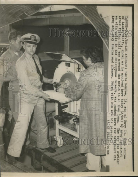 1950 Press Photo Boy Polio Victim Denis Monroe Transported in Iron Lung - Historic Images