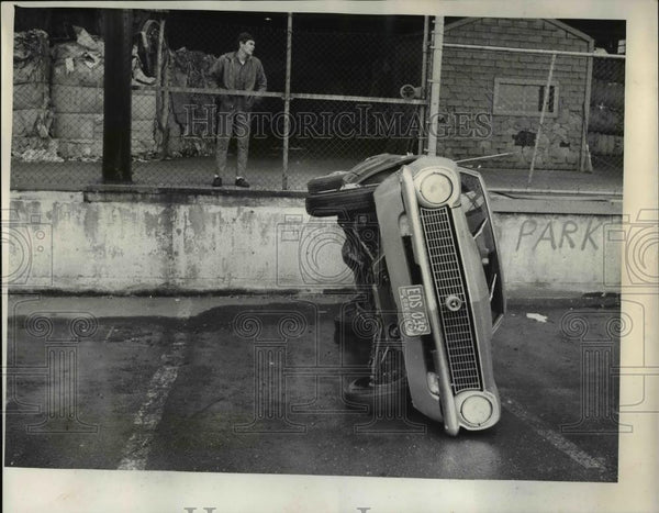 1969 Press Photo Small Car Lies Forlornly On Its Side At Fry Roofing Co