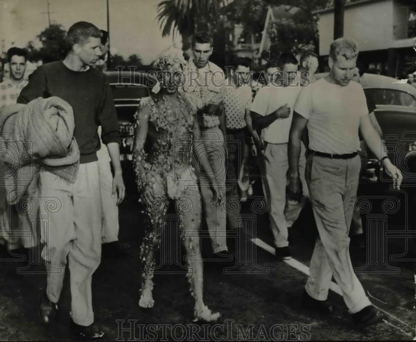 1952 Press Photo Unidentified students daubed with honey and feathers - orb63202 - Historic Images