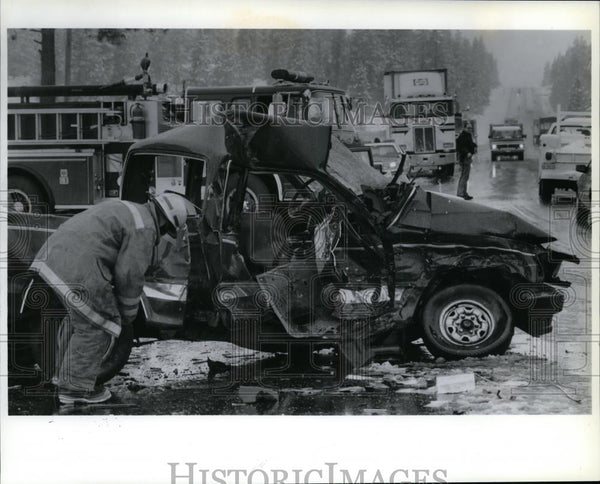 1991 Press Photo Firefighter Inspects Wreckage of Pickup Truck on US Hwy 395 - Historic Images