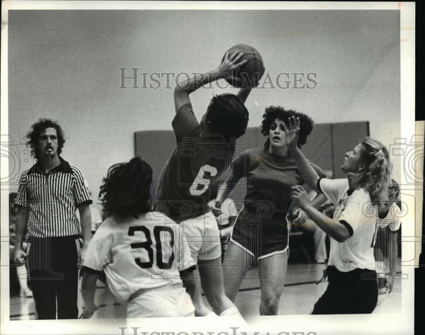 Press Photo Tire and Wheel against Old Front Bar basketball game - cvb69143 - Historic Images