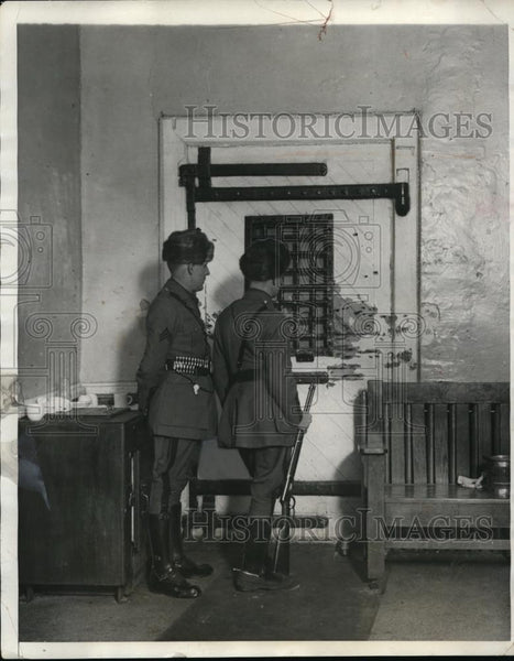 1929 Press Photo State Troopers Looking at Bullet Riddled Doors Inside Prison - Historic Images