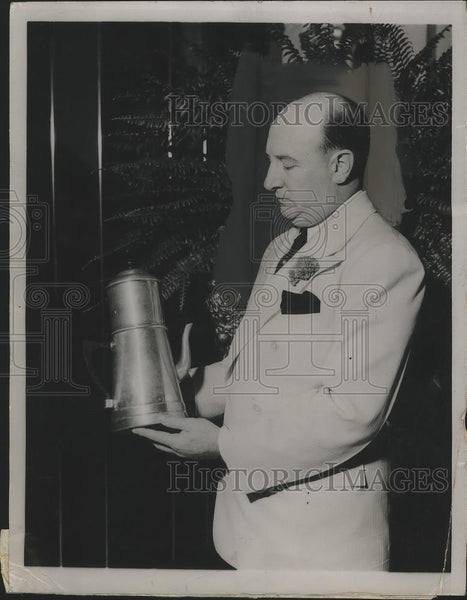 1937 Press Photo Col.Seymour Weiss hold a Governor' Yacht Cup Trophy - nef63856 - Historic Images
