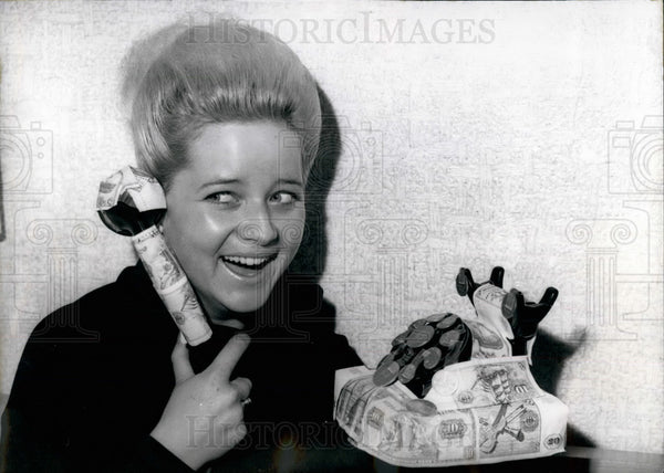 1964 Press Photo Telephone decorated with banknotes and coins - KSB19199 - Historic Images