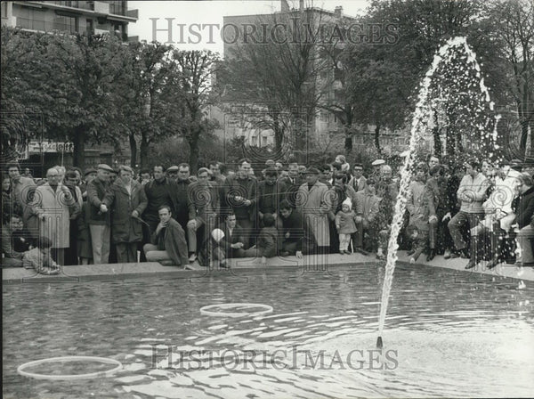 1972 Pierre Creusevaut at a Trout Filled Fountain in Clichy - Historic Images