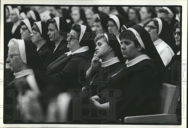 Cardinal John P. Cody address a group of nuns - Historic Images