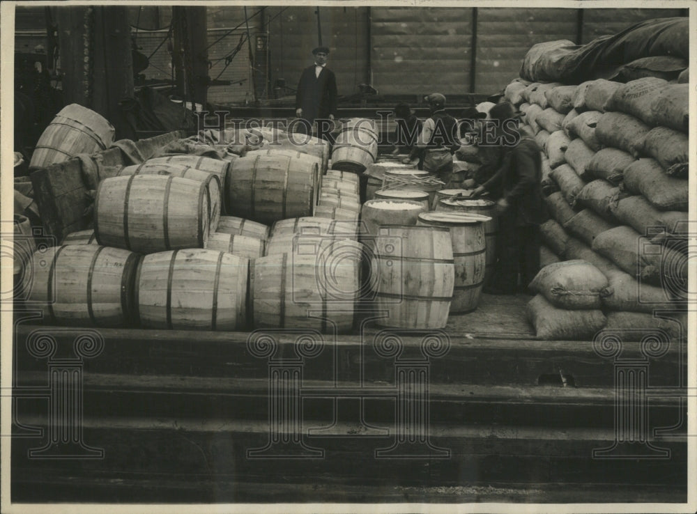 1919 Press Photo hundreds pounds sugar laying rears