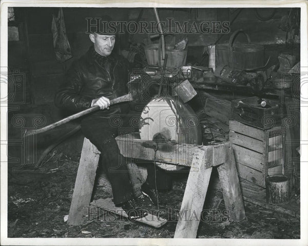 1938 Man Sharpening Ax On Grindstone - Historic Images