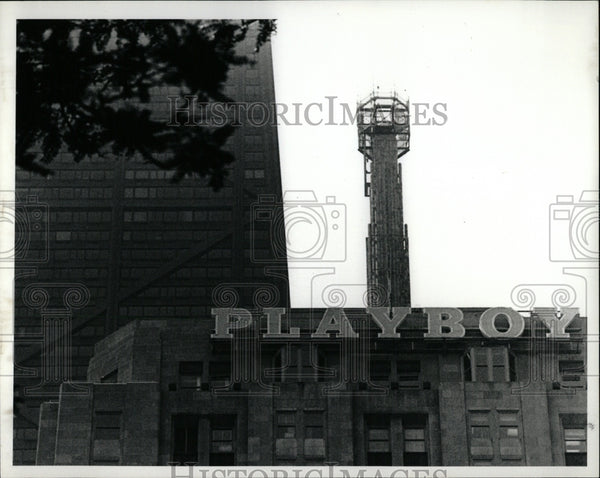 1989 Press Photo Playboy building sign remove Pamolive - RRW57073 - Historic Images