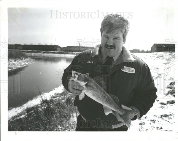 1992 Press Photo Treatment Plant Supt Holding Walleye  - Historic Images