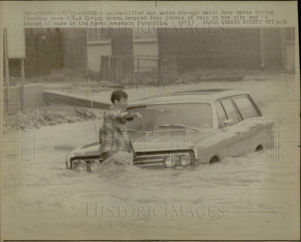 1973 Press Photo Man wades flood Spring storm water  - Historic Images