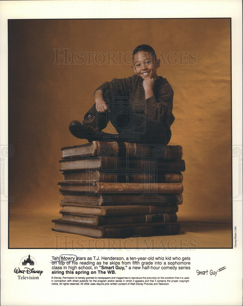 Press Photo Smart Guy Series Actor Mowry Sitting On Large Books Promotional - Historic Images
