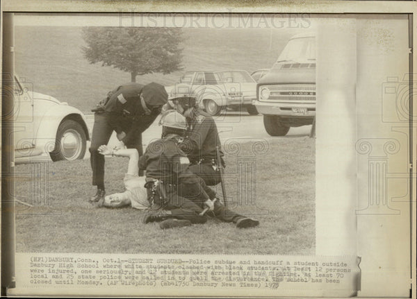 1975 Press Photo Student Subdued By Police at Danbury High School - Historic Images