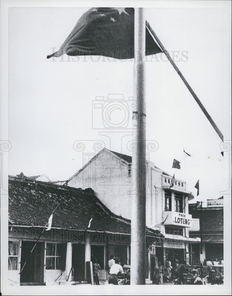 1955 Press Photo Communist Chinese flag flies on Bandung, Indochina. - Historic Images