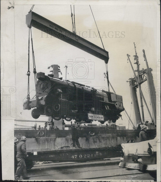 1956 Press Photo One of six India bound locomotives aboard Navy ship. - Historic Images
