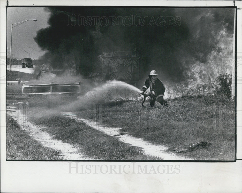 1979 Press Photo A fireman runs for cover during a car fire on Interstate  275