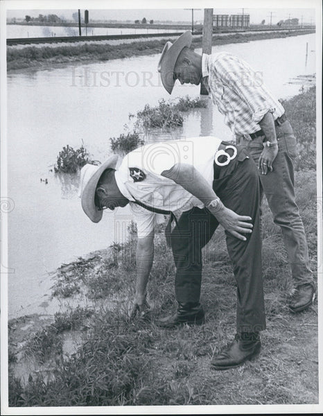 1955 Press Photo Vince Bianco, Sheriff Measures Flood Waters - Historic Images