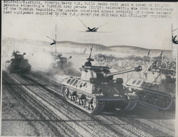 1948 Press Photo Heavy U.S. built tanks roll past a crowd attending a - Historic Images
