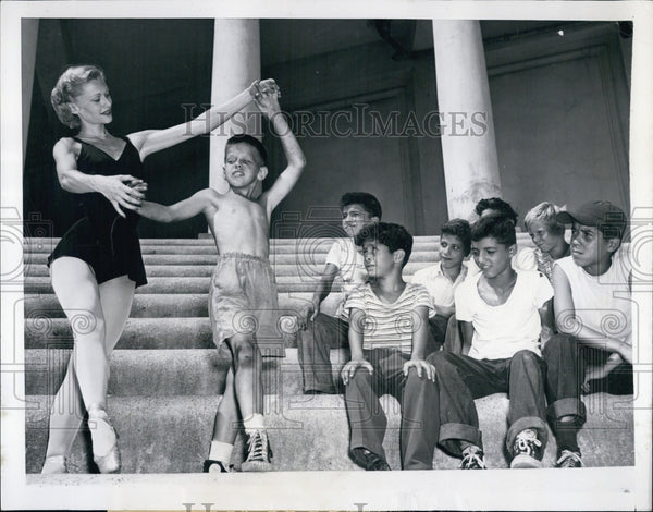 1951 Ballerina Paula Lloyd teaches Bobby McKenna to twirl - Historic Images
