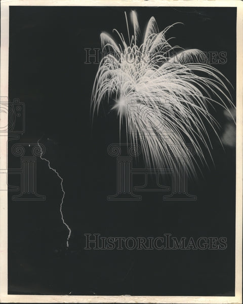 1972 Fireworks show during thunderstorm - Historic Images
